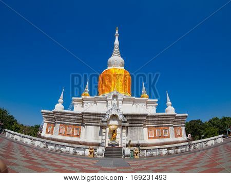 Ancient pagoda architecture In Thailand, Phra That Na Dun , Maha Sarakham Province with blue sky background