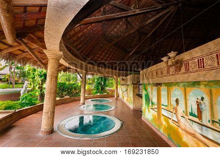 Holguin Province, Playa Pesquero hotel, Cuba, Sep. 4, 2016, mesmerizing gorgeous fragment of view of outdoor hydro massage Jacuzzi  in cozy inviting room