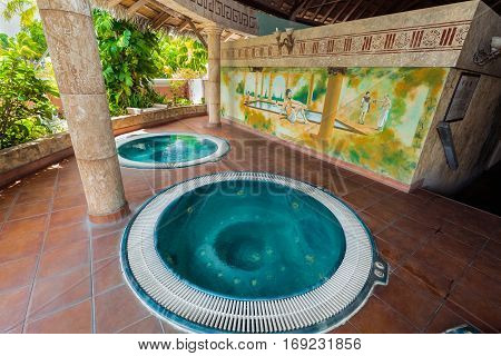 Holguin Province, Playa Pesquero hotel, Cuba, Sep. 4, 2016, gorgeous amazing inviting view of outdoor spa room with hydro massage jacuzzi