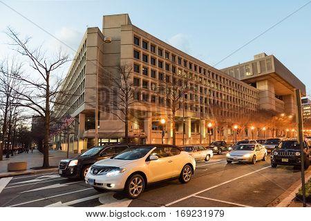 Washington DC, USA - December 29, 2016: FBI Federal Bureau of Investigation Headquarters on Pennsylvania avenue with cars