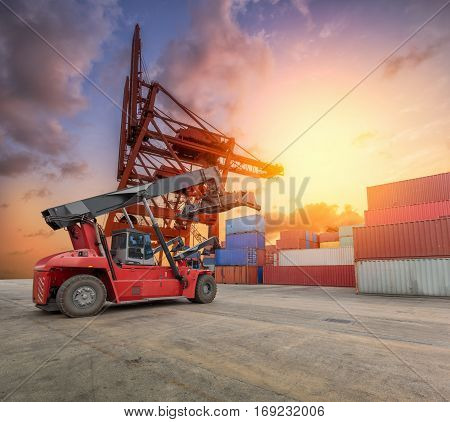 Industrial Container Cargo freight ship for Logistics Import Export with big crane at harbor.