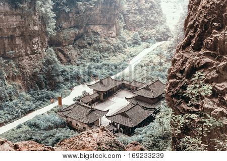 Antique Chinese historical tavern in the woods with vintage color tone and without people Wulong National Park Chongqing China
