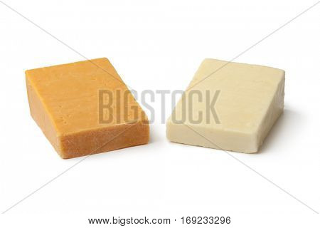 Pieces of traditional english cheese, red leicester and mature cheddar on white background