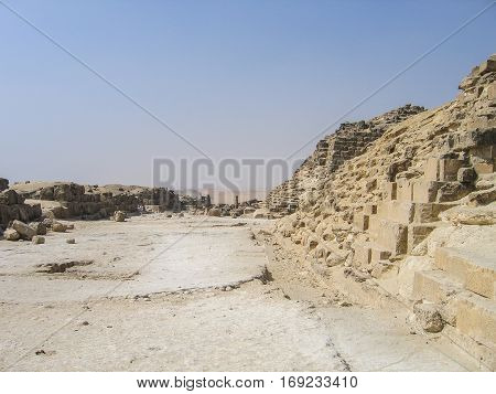 Great pyramids in Giza with ruins during daytime