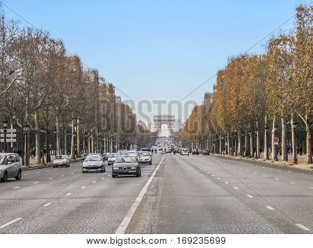 Paris, France - December 18, 2005: Champs Elysees road with traffic and Arc de Triomphe arch