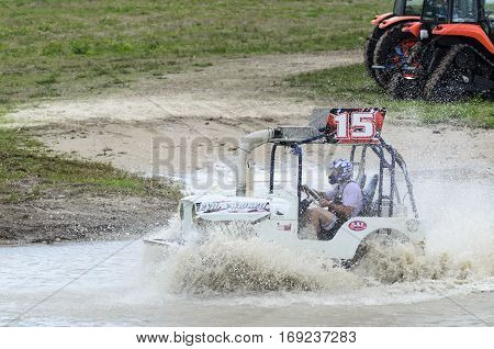 Naples Florida USA - March 3 2012: Swamp buggy churns up muddy bottom of race course