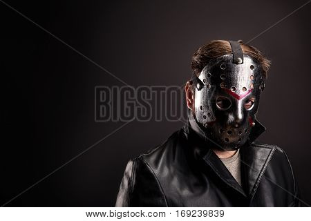 Bloody murderer in hockey mask portrait