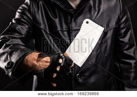 Maniac with knife on dark background