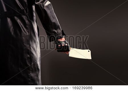 Killer holding meat cleaver in hand.