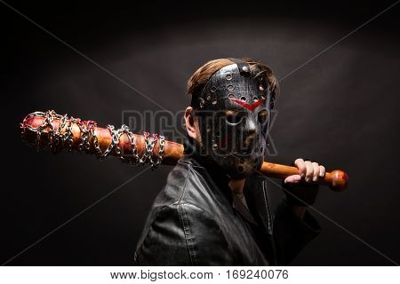 Bloody maniac in mask and black leather coat