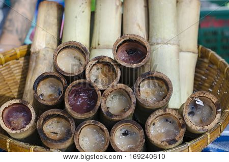 Kao lam glutinous rice roasted in bamboo joints