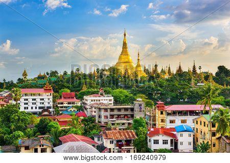 Yangon, Myanmar city skyline with Shwedagon Pagoda.