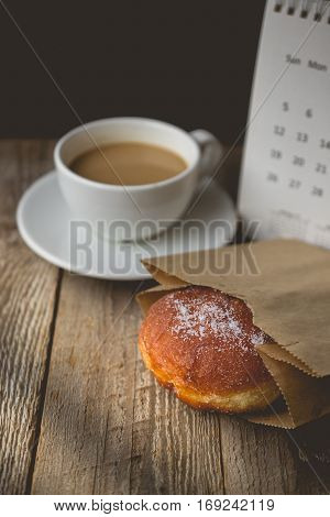Relax time with Hot Coffee and Donut on wood Background used for food ad or website promote. Snacks for people to work in the rush hour