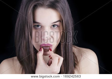 Young Woman Holding A Chocolate Candy In Her Mouth.