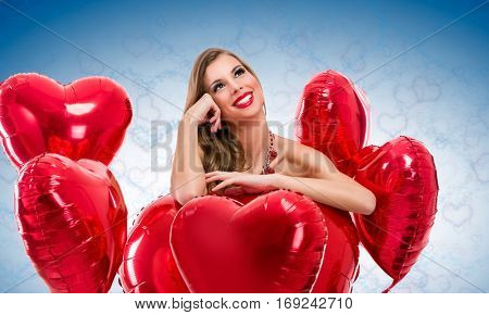 Beautiful young woman looks up with a red heart yearning for her love