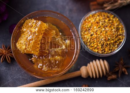 healthy honeycomb, pollen, propolis, honey on the table