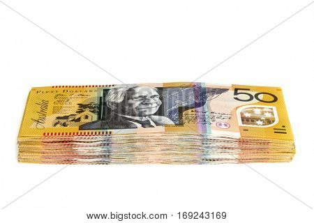 Stack of Australian money.  Fifty dollar bills.  Side view, isolated on white.