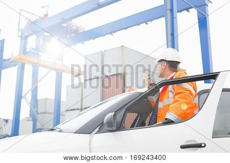 Typical scene from a shipping port with workers going about their daily tasks