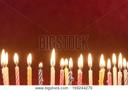 colorful birthday candles composition with shiny red frame