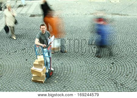 delivery guy in a crowd of motion-blurred people.