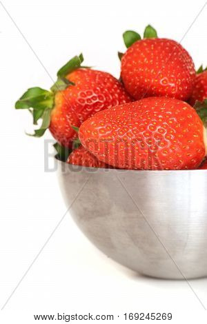Close up of strawberry in metal bowl isolated on white