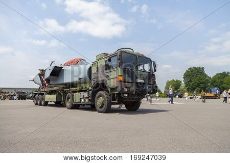 BURG / GERMANY - JUNE 25 2016: german army MAN GL truck with a disassembled Panavia Tornado aircraft stands on open day in barrack burg / germany at june 25 2016.