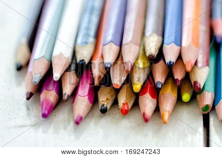 Bunch of used color pencils broken tips.