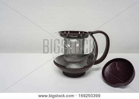 isolated close up transparent teapot in white background