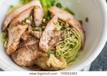 Green Noodle and Dumpling with Roasted Pork Selective Focus