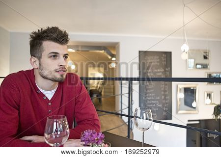 Thoughtful man looking away in cafe