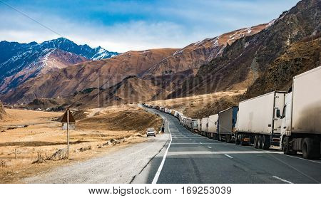 military road in Georgia with truks queue