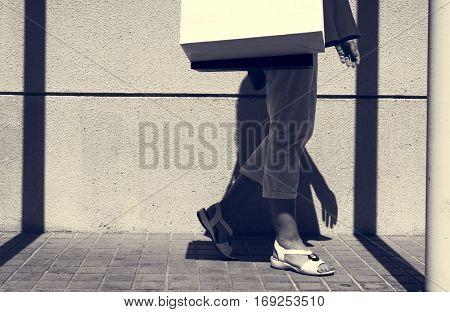 Woman walking around with shopping bag