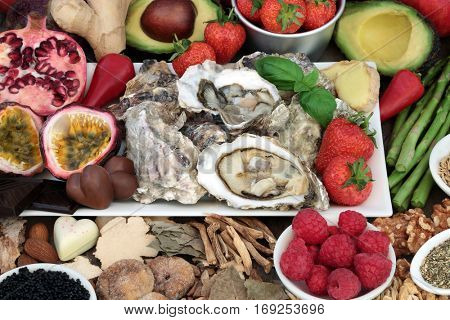 Aphrodisiac food selection for good sexual health forming a background.