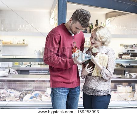Young couple discussing over product outside cafe