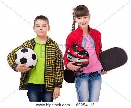 playful schoolchildren with sport skate and ball in hands isolated on white background