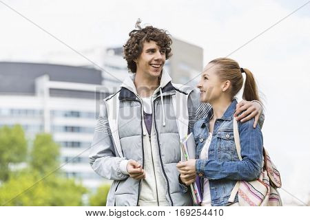 Happy young college students at campus