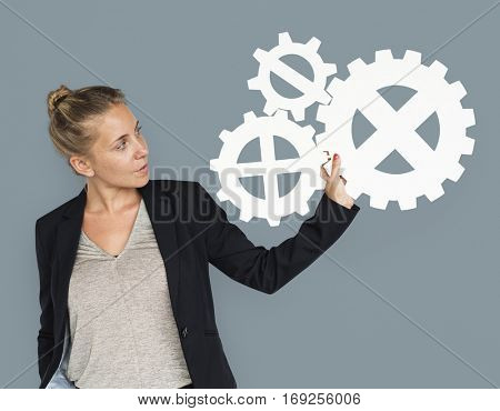 Businesswoman Holding Gear Symbol Connection Concept