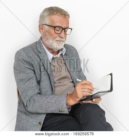 Businessman Writing Notebook Lecture Journal Concept
