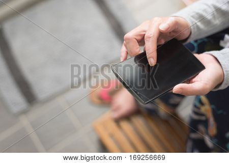 woman use smartphone at the toilet