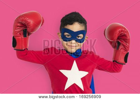 Young asian kid in super hero costume with gloves