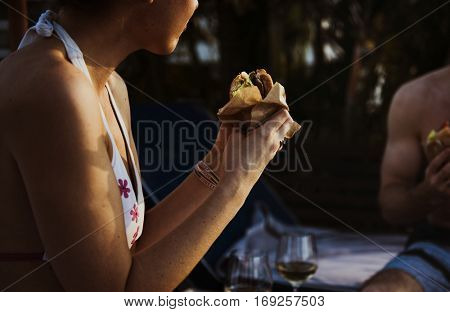 cropped image of a woman eating