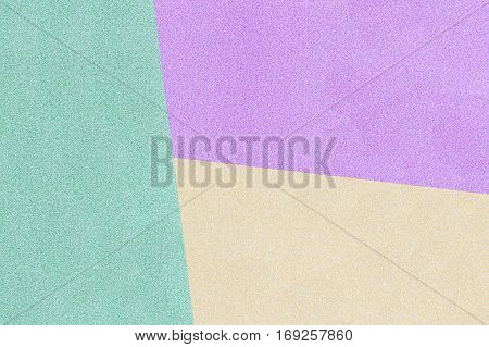 Green, Yellow And Purple Pastel Background. Top View.
