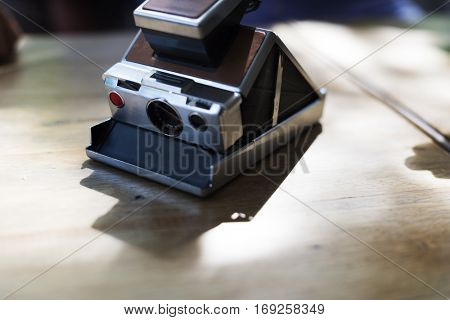Vintage retro instant camera on table