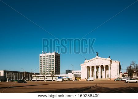 Gomel Belarus - March 27 2016: Gomel Drama Theater located on Lenin Square with her for moving cars