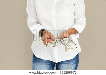 Person holding money cash dollar bills
