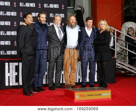 Gil Birmingham, Chris Pine, David Mackenzie, Taylor Sheridan and Julie Yorn at Jeff Bridges Hand And Footprint Ceremony held at the TCL Chinese Theatre IMAX in Hollywood, USA on January 6, 2017.
