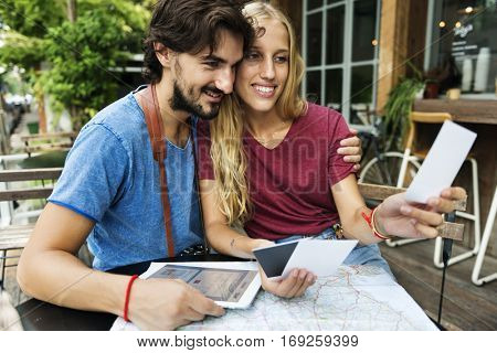 Couple looking at holiday photos restaurant