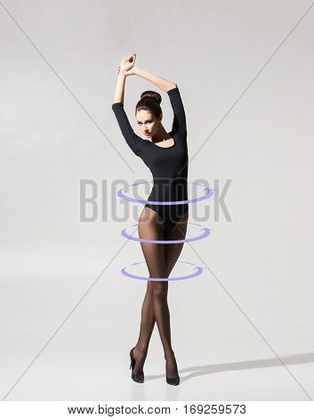 Fit and seductive girl in pantyhose. Woman with perfect body. Weight loss, fitness, sport and diet concept.