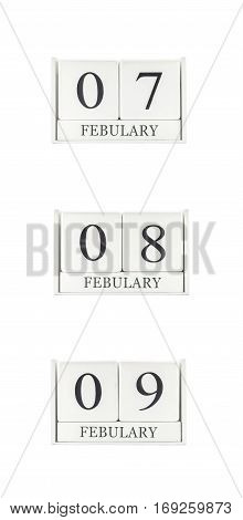 Closeup group of white wooden calendar with black 7 8 9 february word three date calendar isolated on white background