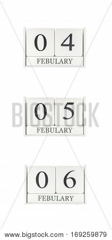 Closeup group of white wooden calendar with black 4 5 6 february word three date calendar isolated on white background